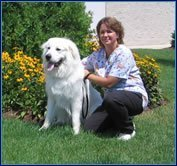 Team member Maria with a large white dog